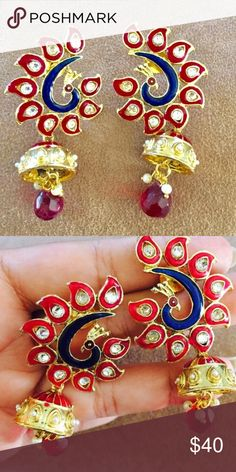 """Peacock design statement earrings Statement post back earrings with pearls and stone detailing . About 3.5"""" long Jewelry Earrings"""