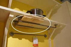 Use towel bars, mounted on the underside of a shelf, to store shallow items.