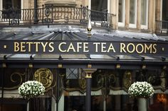 Betty's tea room in Harrogate. A fantastic place to take tea, eat cake and watch the world go by. Yorkshire England, North Yorkshire, Visit Yorkshire, French Beach, Room London, Uk Holidays, Nude Beach, England And Scotland, Beautiful Architecture