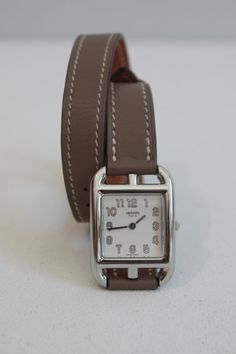 HERMES  watch lady model Cape Cod rectangular steel case.  white dial signed with indication hours in Arabic numerals.  Bracelet double round leather with stitched seams gland.