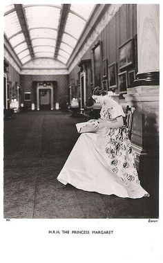 Princess Margaret reading in the Picture Gallery at Buckingham Palace