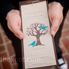 The brown and teal oak tree and bird programs were a DIY project: hole-punched and tied with twine.