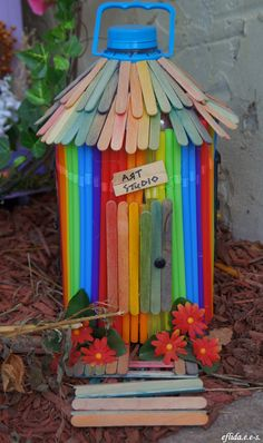 A fairy house made of colored sticks and recycled plastic straws and water bottle at Michigan Renaissance Faire 2012.