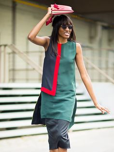 A colorblocked shift dress is worn with a black pencil skirt and a red clutch