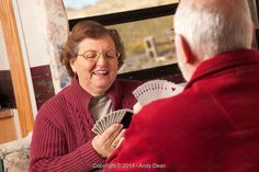 Happy Senior Adult Couple Playing Cards in Their Trailer RV - Stock Photos & Images | Stockafe.com