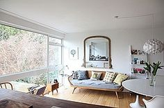 Location image - Ercol Studio Couch + Saarinen Tulip table, in a 60's house.