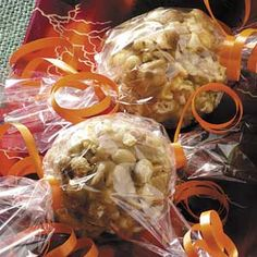 Peanut Butter Popcorn Balls.  Are the best way of decorating the caramel popcorns and give them out, in a very simple and crative way, and when you try them you would have no comments only to have one of those!