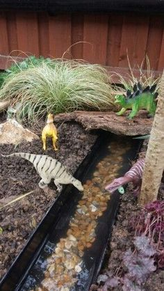 Dinosaur Garden - Everyone needs one of these - maybe add little army men .Dinosaur Garden - Everyone needs one of these - maybe add little army men! , needs this dino garden Window Art Kids Outdoor Play, Outdoor Play Spaces, Backyard For Kids, Garden Kids, Childrens Play Area Garden, Baby Garden Ideas, Fairy Gardens For Kids, Easy Garden, Garden Ideas Children