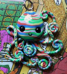 A polymer clay octopus pendant.  The background for this one is a high school french textbook.
