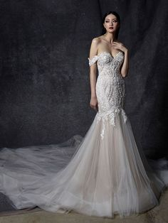OCTAVIA Enchant guests with this jaw dropping full length mermaid silhouette. Complete with detachable sleeves, Octavia is sure to wow guests. Walk on air with its full tulle train as lace cascades from the hips Elegant Wedding Dress, Dream Wedding Dresses, Bridal Dresses, Queen Wedding Dress, Queen Dress, Wedding Dress Trends, Bridal Collection, Dress Collection, Blue By Enzoani