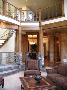 love the mix of wood and stone inside--columns and floor!
