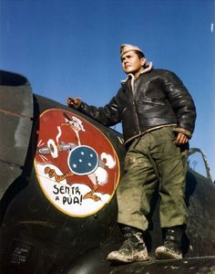 Master Sergeant Robson Saldanha poses beside the bird insignia of the First Brazilian Fighter Squadron painted on a P-47 Thunderbolt, Italy, 1944. The slogan reads 'Senta a Pua', or roughly, 'Hit Them Hard'. (Photo by PhotoQuest/Getty Images)