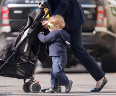 Prince George walking with his nanny, in London