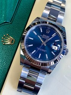 Check out the new Rolex Datejust 41 model in stainless steel with blue baton dial Global Watch Shop have it in stock so buy yours today. Gold Rolex, New Rolex, Men's Rolex, Rolex Watches For Men, Luxury Watches, Men's Watches, Rolex Boutique, Rolex Presidential, Rolex Datejust Ii