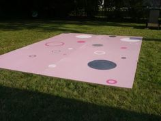 A homemade dancefloor... Ours to be graffiti art instead of painted by a 16 year old girl (as cute as this is).