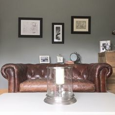 Living room design and decor ideas with walls painted in Farrow and Ball Pigeon with vintage brown Chesterfield leather sofa