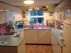 My new ikea DIY kitchen - almost finished! Ringhult yellow white door fronts, light turquoise worktops, splashbacks - glass backed with baby pink sign writer's vinyl