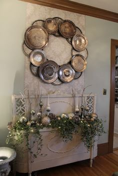 Oversized silver wreath made from vintage silver trays and chargers.......Decorative wood headboard and footboard turned into a planter