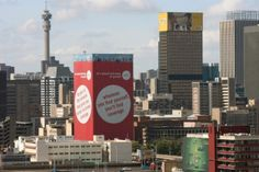 Building wrap installed by Scaff-Tech, Johannesburg. www.scafftech.co.za Seattle Skyline, Times Square, This Is Us, Advertising, Wraps, Tech, Building, Travel, Viajes