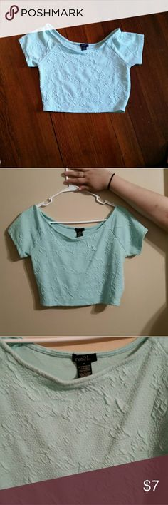Light blue crop top Light blue, floral design, crop top. This picture does not do the color of this shirt justice. It is a lot brighter. I will try to add a more accurate picture when I can Tops Crop Tops