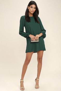 """Lulus Exclusive! Why """"hashtag"""" it out with your old dresses, when you can post up in the Status Update Forest Green Shift Dress?! A simple woven poly bodice includes long puffed sleeves with buttoned cuffs, and a scoop neckline. This day-to-night look is remarkably easy to style, and as fun as it is affordable!"""