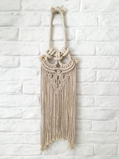 Hi,  Thank you for visiting my Bohemian pIxels Etsy shop.  All Fiber art items are made by me (Miriam) in my studio at Miami, Florida.  You are welcome to follow me on my Instagram account @bohemianpixles  ***  Macrame wall hanging  L: 32 W: 8