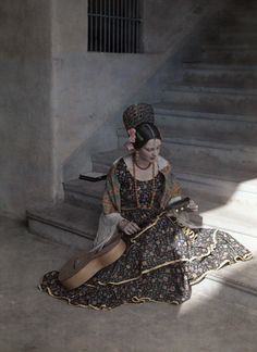Autochrome Jacob J. Gayer. A young girl poses in period clothing with a musical instrument. Dominican Republic. 1920s.