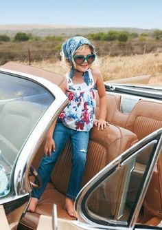 Kids style. what a cute pic in grandpa's cars