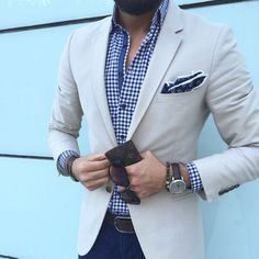 Blue and white gingham under tan with a medallion pocket square.