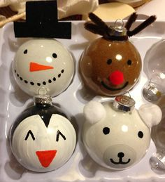 Cute holiday DIY ornaments! Rudolph, snowman, penguin and polar bear!! Clear glass ornament, pledge floor care finish, craft sand, and acrylic paint or paint markers.  cutest diy christmas ornament!!!!!!!! Pour a bit of floor finish inside ornament to coat tip to empty excess, pour some craft sand inside and turn to coat tip to empty excess, paint outside!!!!!!