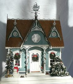 Dollhouse, but the design would make s great glitter house.