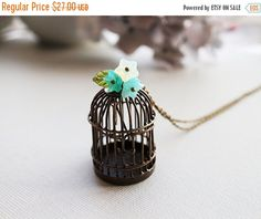 Black Friday Sale Birdcage Necklace. whimsical bird cage in antique bronze with opal green flowers and sea shell bird by lunashineshine on Etsy https://www.etsy.com/listing/183767116/black-friday-sale-birdcage-necklace