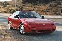 240 SX Nissan 1990 - owned one of these in this exact color and loved it!  I am a car freak, what can I say.  Before I met my Lexus, the longest I ever kept a car was 2 years at the most.  One I only kept for 6 months.