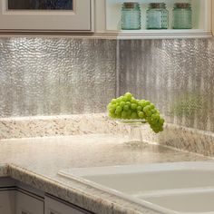 This Backsplash Kit includes six 18-inch by 24-inch backsplash panels, four 4-foot J-Trim pieces, two 18-inch Inside Corner pieces, one package of matching Outlet Covers and four rolls of Double Sided Tile Decorative Wall Tile Adhesive Tape.