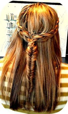 Two side braids pull back and join into a fishtail braid, with the rest of the hair loose.