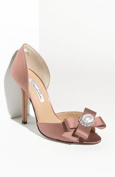 Free shipping and returns on Oscar de la Renta Satin Pump at Nordstrom.com. High-sheen satin fashions a wrapped-heel pump with a jewel-topped bow at the open toe. A band of elastic along the interior heel cup creates a virtually slip-free fit.