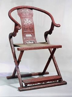 Folding armchair of carved red lacquer on wood, 1500-1560, Ming dynasty, Chinese. Height: 114.5 cm. © V Images.