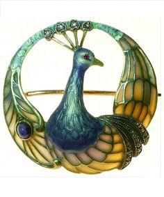 An Art Nouveau 'Peacock' brooch, Austrian, 1890-1900s. Composed of plique-à-jour enamel, guilloché enamel, cabochon sapphires, ruby, rose-cut diamonds, 14K gold and silver. #ArtNouveau #brooch