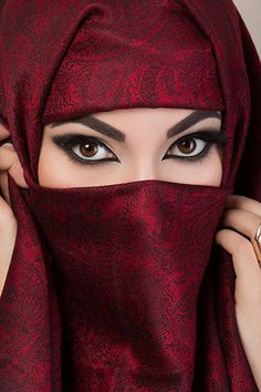 Portrait of beautiful arabian girl hiding her face behind red niqab with paisley ornament Beautiful Arab Women, Most Beautiful Eyes, Stunning Eyes, Beautiful Girl Photo, Beautiful Hijab, Most Beautiful Indian Actress, Beautiful Eyes Pictures, Niqab Eyes, Arabian Eyes