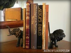 Cheap bookends!!! Cut in half plastic animals from the Dollar Tree and glue them to plastic picture frames and then spray paint them!!!