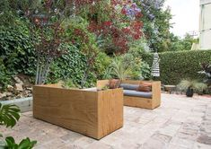 Custom outdoor furniture by Work and Sea allows the duo to soak up the sun in their gorgeous outdoor garden. #outdoorfurniture