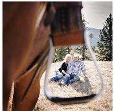 Cute Western engagement photo perspective through a horse's stirrup! #countrywedding