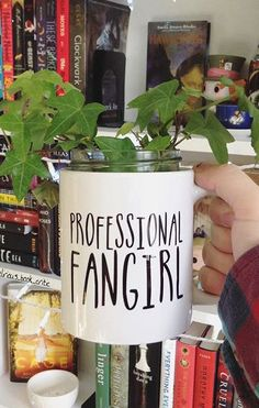 We love this clever idea—got too many bookish mugs for all your fandoms? Turn one into a planter, and let it house your new reading companion, perfect on a windowsill or bookshelf. Love this Professional Fangirl mug from Redbubble.