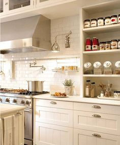White subway tile kitchen w task lighting and open shelves