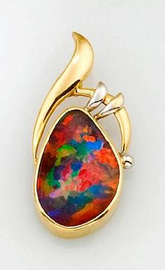 Freeform boulder opal pendant, handcrafted in two-tone 18k gold