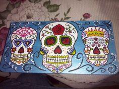 Caja de madera con diseño de Calaveras Mexicanas.