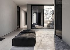 Cloudy shades of gray make for a mysterious interior in this single family home in Poland from Tamizo Architects. Home Interior Design, Interior Architecture, Interior And Exterior, Tamizo Architects, White Wood Floors, Wood Flooring, Contemporary Interior, Contemporary Style, Interiores Design