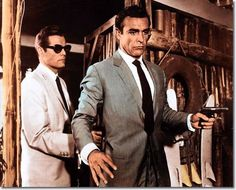 Jack Lord as CIA agent Felix Leiter and Sean Connery in the first James Bond film Dr. No (1962).