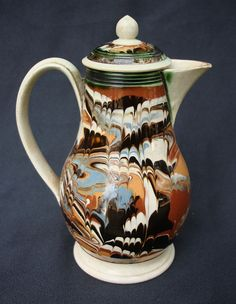 English baluster form cream jug ca. 1780 with combed surface marbled slip design