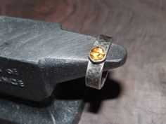 Citrine and hammered sterling. Darpinian